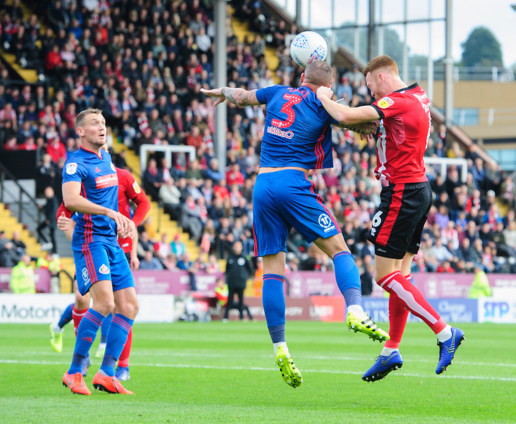 Lincoln City's Cian Bolger vies for possession with Sunderland's Joel Lynch<br /> <br /> Photographer Chris Vaughan/CameraSport<br /> <br /> The EFL Sky Bet League One - Lincoln City v Sunderland - Saturday 5th October 2019 - Sincil Bank - Lincoln<br /> <br /> World Copyright © 2019 CameraSport. All rights reserved. 43 Linden Ave. Countesthorpe. Leicester. England. LE8 5PG - Tel: +44 (0) 116 277 4147 - admin@camerasport.com - www.camerasport.com