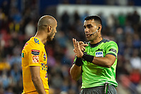 HARRISON, NJ - MARCH 11: Referee Juan Gabriel Calderon talks with Guido Pizarro #19 of Tigres UANL during a game between Tigres UANL and NYCFC at Red Bull Arena on March 11, 2020 in Harrison, New Jersey.