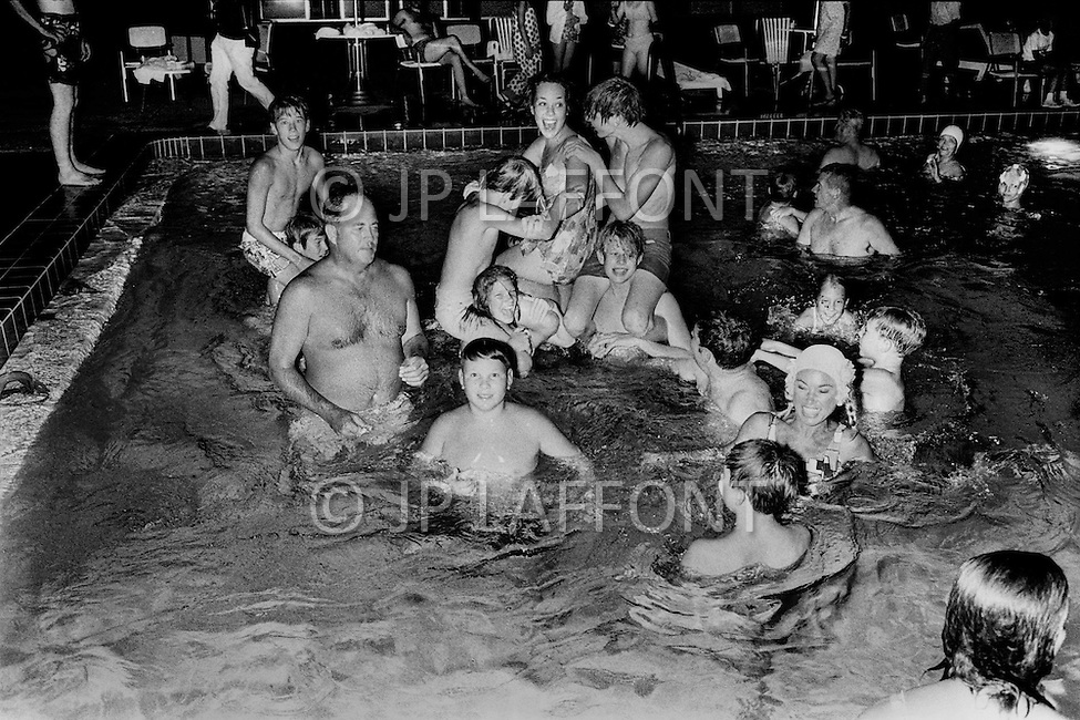 July 16, 1969, Cape Kennedy, Florida, USA --- The night that preceded the departure of Apollo XI from Kennedy Space Center to the Moon was an ongoing party. People danced and spent countless hours in swimming pools to pass time. It was an unforgettable night filled with feverish excitement. The least resilient collapsed and finally went to sleep from 5 am to 8 am. The take-off happened at 9:23 am on July 16, 1969 under a torrid sun.--- Image by © JP Laffont
