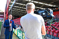 A Sky Sports presenter does a piece to camera during AFC Bournemouth vs Manchester City, Premier League Football at the Vitality Stadium on 25th August 2019