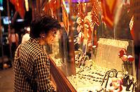 An old lady window shopping outside a jewellery shop in Hong Kong..