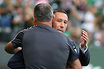 20 June 2015: Portland head coach Caleb Porter (behind) and Houston head coach Owen Coyle (IRL) embrace before the game. The Portland Timbers FC hosted the Houston Dynamo at Providence Park in Portland, Oregon in a Major League Soccer 2015 regular season match. Portland won the game 2-0.