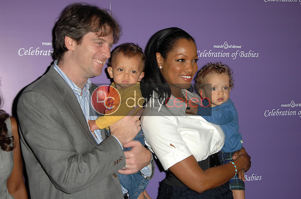 Mike Nilon with Garcelle Beauvais and family<br />
