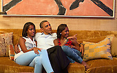 United States President Barack Obama and his daughters, Malia, left, and Sasha, watch on television as First Lady Michelle Obama takes the stage to deliver her speech at the Democratic National Convention, in the Treaty Room of the White House, Tuesday night, September 4, 2012. .Mandatory Credit: Pete Souza - White House via CNP