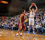 BROOKINGS, SD - FEBRUARY 6:  Mike Daum #24 from South Dakota State spots up for a jumper over D.J. McCall #32 from IUPUI during their game Saturday evening at Frost Arena in Brookings. Photo by Dave Eggen/Inertia)