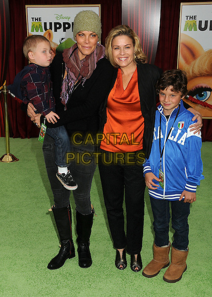 "Cat Cora & guests.""The Muppets"" Los Angeles Premiere held at the El Capitan Theatre, Hollywood, California, USA..November 12th, 2011.full length suit black orange top blue jacket .CAP/ADM/BP.©Byron Purvis/AdMedia/Capital Pictures."
