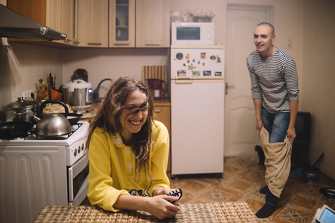 Katerine and Alexander during their dinner cooking evening. Ribnita, Transnistria