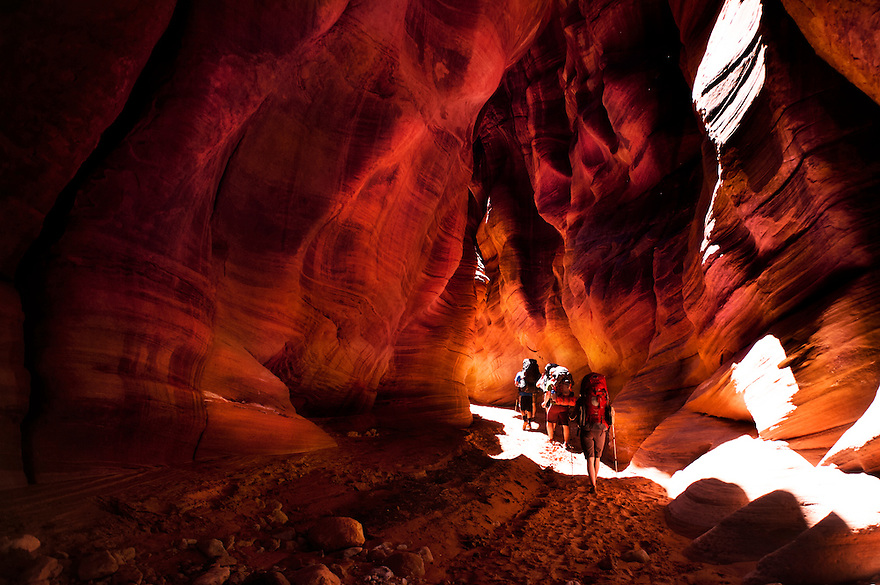 A group of backpackers hikes through Buckskin Gulch in southern Utah.