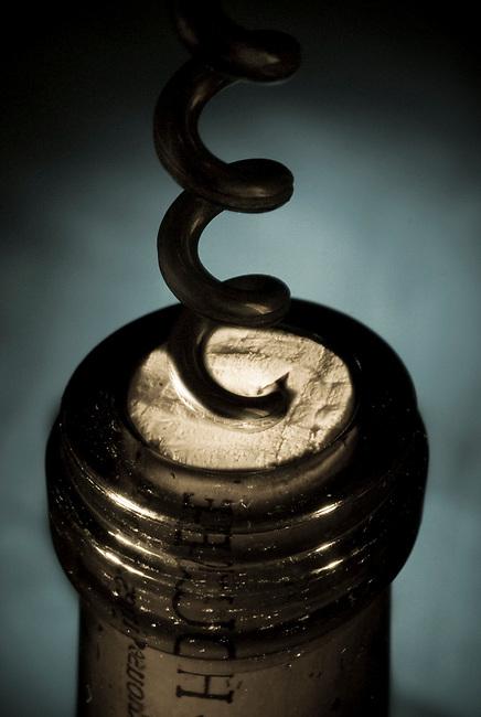 Corkscrew opens wine bottle