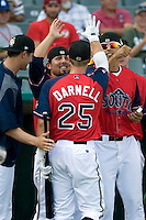 San Antonio Missions third baseman James Darnell #25 is greeted by his teammates during the home run derby before the Texas League All Star Game played on June 29, 2011 at Nelson Wolff Stadium in San Antonio, Texas. The South All Star team defeated the North All Star team 3-2 and Darnell was awarded the MVP award. (Andrew Woolley / Four Seam Images)