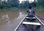Native guide paddling through the rainforest of Peru.
