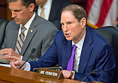 """United States Senator Ron Wyden (Democrat of Oregon) questions US Attorney General Jeff Sessions during testimony before the US Senate Select Committee on Intelligence to  """"examine certain intelligence matters relating to the 2016 United States election"""" on Capitol Hill in Washington, DC on Tuesday, June 13, 2017.  In his prepared statement Attorney General Sessions said it was an """"appalling and detestable lie"""" to accuse him of colluding with the Russians.<br /> Credit: Ron Sachs / CNP<br /> (RESTRICTION: NO New York or New Jersey Newspapers or newspapers within a 75 mile radius of New York City)"""
