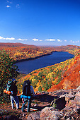 Hikers pause at the the overlook at the East end of Lake of the Clouds, in Porcupine Mountain Wilderness State Park in Michigan's Upper Peninsula  during fall color.