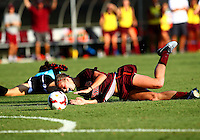 WINSTON-SALEM, NORTH CAROLINA - August 30, 2013:<br />  Paige Brown (1) of Louisville University falls to the ground after crashing into Ashley Meier (15) of Virginia Tech during a match at the Wake Forest Invitational tournament at Wake Forest University on August 30. The game ended in a 1-1 tie.