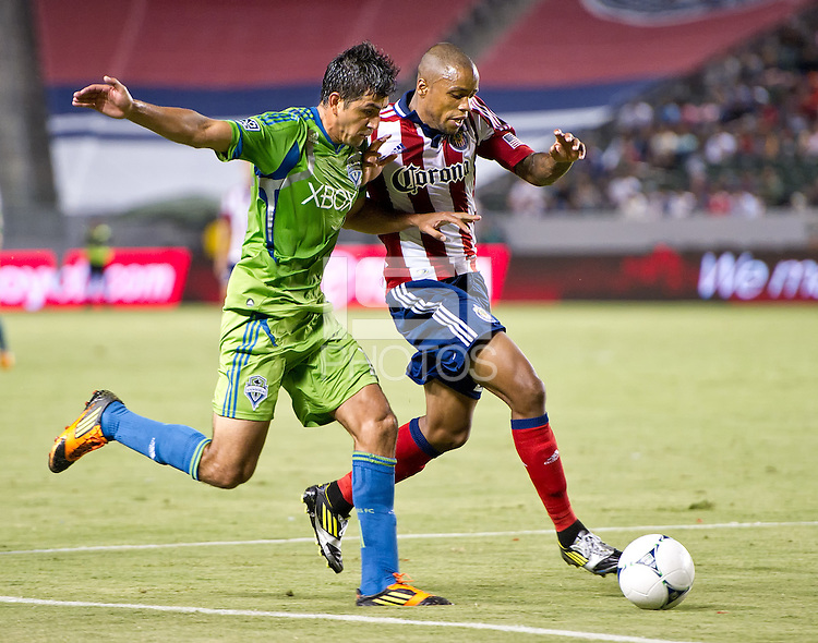 CARSON, CA - August 25, 2012: Seattle defender Leo Gonzalez (12) and Chivas USA forward Tristan Bowen (20) during the Chivas USA vs Seattle Sounders match at the Home Depot Center in Carson, California. Final score, Chivas USA 2, Seattle Sounders 6.