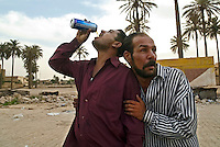 Baghdad, Iraq, June 2, 2003.Achmed, left, and Ali, right, get drunk on cheap Turkish beer. Alcoolism is on a sharp rise in Baghdad as alcool can be purchased and drunk freely in public after the fall of Saddam's regime.