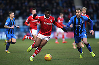 Mamadou Thiam of Barnsley in action as Gillingham's Dean Parrett looks on during Gillingham vs Barnsley, Sky Bet EFL League 1 Football at The Medway Priestfield Stadium on 9th February 2019