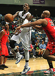 Reno Bighorns Mo Charlo gets fouled by Idaho Stampede's Antoine Walker during a basketball game Sunday, April 1, 2012 in Reno, Nev. Idaho won 108-99..Photo by Cathleen Allison