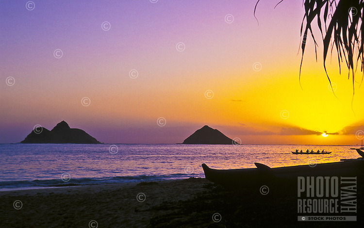 A view of the Mokulua Islands from Lanikai beach at sunrise, on the Windward side of Oahu; the islands are part of the Hawaii State Seabird Sanctuary