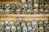 Rwanda. Western province. Nyange. Skulls of Tutsis, killed in the collapse of the catholic church during the 1994 genocide. Mortal remains laid on shelves at the Genocide Memorial. In Nyange,  Father Seromba, a hutu extremist, gave the order to bulldoze his own church on top of his own congregation of 3'000 tutsi people. © 2007 Didier Ruef