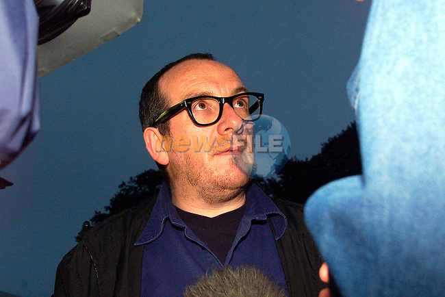 Elvis Costello being interviewed at the U2 Concert in Slane Castle .Pic Fran Caffrey Newsfile