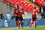 LONDON, ENGLAND - MARCH 29: Louis Moult of Wrexham (centre) celebrates after he scores the opening goal against North Ferriby United during the FA Carlsberg Trophy Final 2015 at Wembley Stadium on March 29, 2054 in London, England. (Photo by Dacid Horn/EAP)
