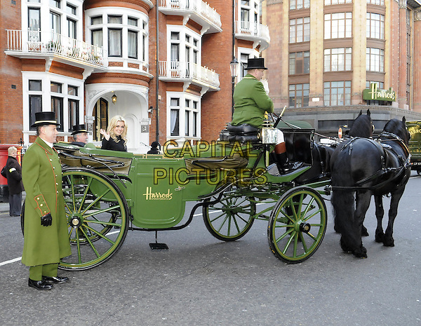 KATHERINE JENKINS.opens Harrods Winter Sale..Knightsbridge, London, England..27th December 2008 .sitting in Harrods horse drawn carriage.CAP/FIN.©Steve Finn/Capital Pictures.