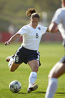 Shannon MacMillan kicks the ball during a 0-0 tie with Japan in San Diego, Calif.,  January 12, 2003.
