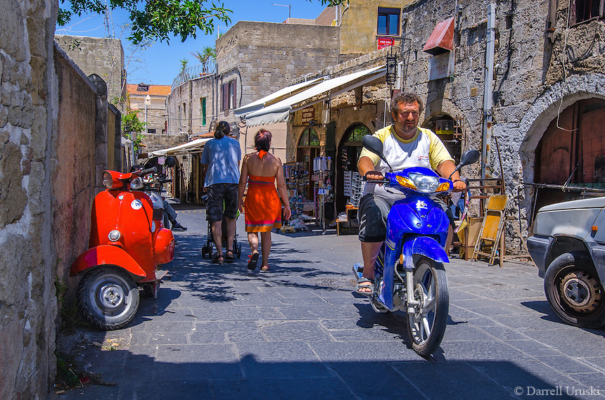 Fine Art Print Photograph. Classic street scene of a scooters and a rider in the streets of Rhodes, Greece.