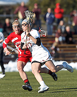 Boston College midfielder Mikaela Rix (17) on the attack as Boston University attacker Nell Burdis (16) defends..Boston College (white) defeated Boston University (red), 12-9, on the Newton Campus Lacrosse Field at Boston College, on March 20, 2013.