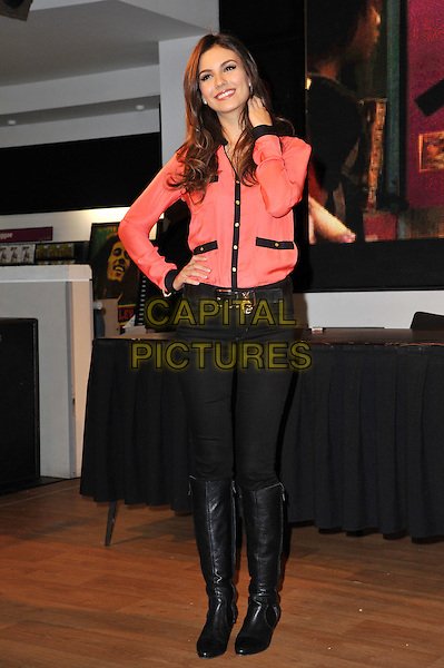 Victoria Justice.Fans of the hit Nickelodeon TV series VicTORious get the chance to meet the star, Victoria Justice, in person, when she visits HMV's flagship Oxford Street store in London's West End to sign copies of the VicTORious album, DVD & Game..22nd February 2012.full length black pink blouse hand on hip jeans denim boots.CAP/BF.©Bob Fidgeon/Capital Pictures.