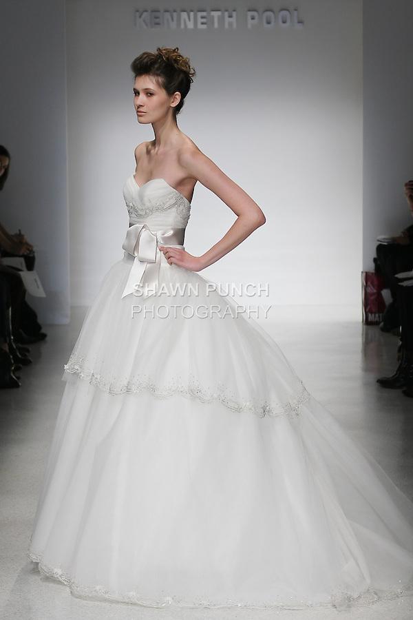 Model walks runway in a Zuzanna wedding dresses by Amsale Aberra, for the Kenneth Pool Spring 2012 Bridal runway show.
