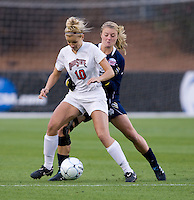 Jessica Schuveiller (12) of Notre Dame tries to take the ball away from Paige Maxwell (10) of Ohio State during the first game of the NCAA Women's College Cup at WakeMed Soccer Park in Cary, NC.  Notre Dame defeated Ohio State, 1-0.