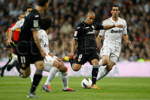 08.04.2012. Madrid, Spain.  La Liga matchday 32th  match played between Real Madrid CF vs Valencia (0-0) and falls to 4 points behind Barcelona, at Santiago Bernabeu stadium. The picture shows Sofiane Feghouli (Midfielder of Valencia)  Alvaro Arbeloa Coca (Spanish defender of Real Madrid)