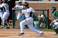 Chris Fritts #7 of the Tennessee Volunteers follows through on his swing at Lindsey Nelson Stadium against the the Manhattan Jaspers on March 12, 2011 in Knoxville, Tennessee.  Tennessee won the first game of the double header 11-5.  Photo by Tony Farlow / Four Seam Images..