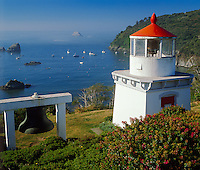 Humbolt County, CA<br /> Morning sun on the Trinidad Memorial Lighthouse &amp; harbor boats on the north California coast