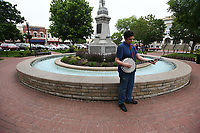 NWA Democrat-Gazette/J.T. WAMPLER Cole Lowe of Bentonville plays banjo Thursday May 9, 2019 while posing for senior photos on the Bentonville square. Lowe began his banjo career playing on the square when he was seven years-old.