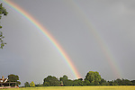 Double rainbow in grey stormy sky, Butley, Suffolk, England, UK