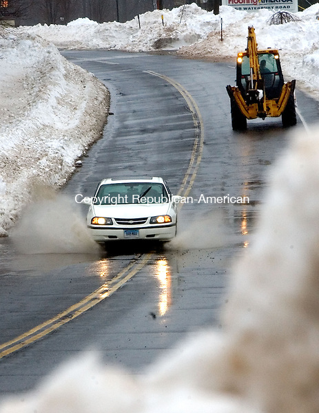 PROSPECT, CT. 11 February 2013-021113SV04-Roadways were starting to puddle up during heavy rain on Rt. 69 in Prospect Monday. Storm drains were covered by this weekend snowfall and were creating hazardous driving conditions..Steven Valenti Republican-American