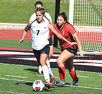 RICK PECK/SPECIAL TO MCDONALD COUNTY PRESS  McDonald County's Leslie Yousey clears a ball from in front of the Lady Mustangs' goal during a 1-0 loss to Carl Junction in the Missouri Class 3 District 11 Girls' Soccer Tournament on May 13 at MCHS.