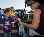 Children from the Boys and Girls Club Reno hand out tie-dyed towels they made to golfers at the Microsoft 8th Annual Charity Golf Tournament held at Red Hawk Golf and Resort in Sparks on Friday, August 19, 2016.