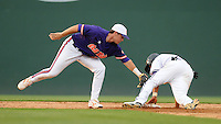 Second baseman Will Muzika (2) of the Furman Paladins steals second base in a game with second baseman Jason Stolz (2) the Clemson Tigers defending on Tuesday, May 10, 2011, at Fluor Field in Greenville, S.C. Muzika is from Dorman High School in Spartanburg. Photo by Tom Priddy / Four Seam Images