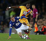 Bryan Oviedo of Everton tackled by Wilfried Zaha of Crystal Palace during the Premier League match at Goodison Park Stadium, Liverpool. Picture date: September 30th, 2016. Pic Simon Bellis/Sportimage