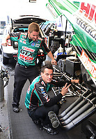Sept. 16, 2012; Concord, NC, USA: NHRA crew members for funny car driver John Force during the O'Reilly Auto Parts Nationals at zMax Dragway. Mandatory Credit: Mark J. Rebilas-