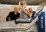 Sophie Leggate from the Hampden Sports Clinic demonstrates the anti-gravity treadmill to Colin Hendry and Gary McAllister