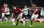 Jack Marriott of Derby County tackles Scott Wharton of Northampton during the FA Cup match at the Pride Park Stadium, Derby. Picture date: 4th February 2020. Picture credit should read: Darren Staples/Sportimage