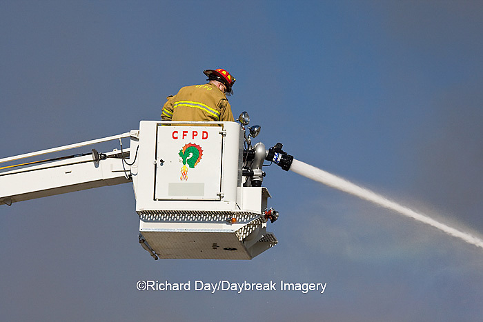 63818-022.14 Firefighters extinguishing warehouse fire using aerial ladder truck, Salem, IL