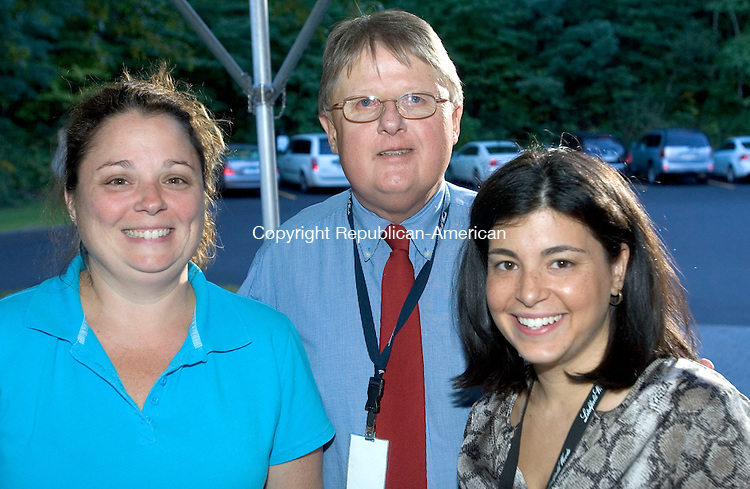 TORRINGTON CT. 18 September 2013-091913SV08-From left, Lee Anne Marciano of Torrington, Mark Loomis, Director of Admissions at Litchfield Woods, and Giovanna Ciesco of Torrington attend the Northwest Connecticut Chamber Business After Hours event at Litchfield Woods in Torrington Wednesday.<br /> Steven Valenti Republican-American