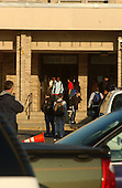 """Bowie, MD - October 23, 2002 -- Parents driving their kids to Benjamin Tasker Middle School create a traffic jam in the parking lot near one of the several main entrances. There were few students observed walking to school due to the fears surrounding the """"Beltway Sniper"""".  Tasker is where an unidentified 13 year-old boy was shot on October 7, 2002.<br /> Credit: Ron Sachs / CNP<br /> (RESTRICTION: NO New York or New Jersey Newspapers or newspapers within a 75 mile radius of New York City)"""