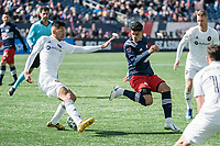 FOXBOROUGH, MA - MARCH 7: Mauricio Pineda #22 of Chicago Fire traps the ball as Gustavo Bou #7 of New England Revolution approaches during a game between Chicago Fire and New England Revolution at Gillette Stadium on March 7, 2020 in Foxborough, Massachusetts.